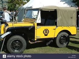 old yellow jeep old automobile association land rover at goodwood revival meeting