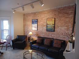 rustic living room with exposed brick u0026 carpet zillow digs zillow