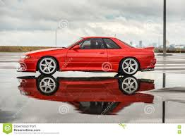 nissan red nissan skyline r 32 red color on a wet road editorial photography