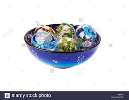 colorful composition of five ornamental eggs from glass which are
