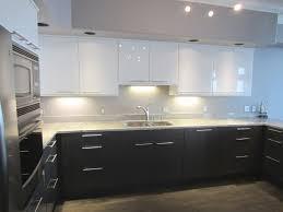 elegant white gloss kitchen with black worktops taste