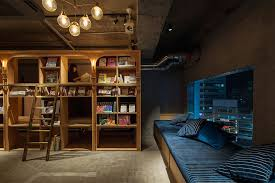 themed shelves bookstore themed tokyo hotel has 1 700 books and sleeping shelves