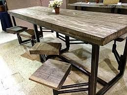 Kitchen Island Tables With Stools Awesome Table With Attached Swinging Stools Found In Scotts