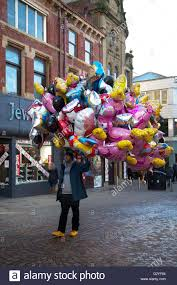 parade balloons for sale balloon seller selling inflated helium balloons on the streets of