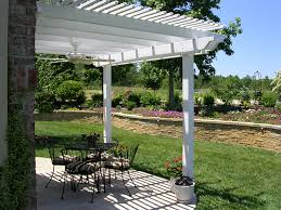 patio transformed with attached low maintenance vinyl pergola kit