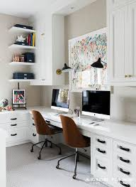home office with built in side by side desks transitional den