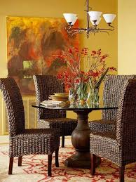 dining room with rattan parson chairs and round pedestal table
