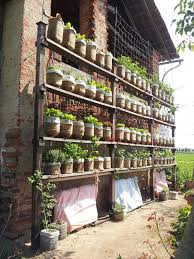 Vertical Gardening by Self Watering Vertical Garden With Recycled Water Bottles 6 Steps