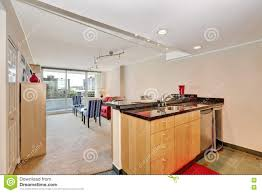 apartment interior kitchen island view with living room stock