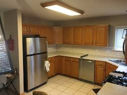 cost to paint kitchen cabinets white paint your cabinets white grey and how your kitchen