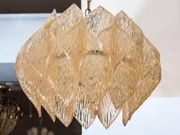 mid century kalmar style chandelier with a folded amber acrylic