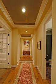 traditional hallway with wide plank floors trey ceiling in