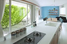 Japanese Modern Interior Design by Architecture Awesome White Kitchen Counter In Green Screen House