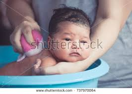 Mom In Bathtub A Baby With Foam On Her Head Stock Images Royalty Free