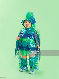 portrait of baby in fish costume for halloween stock photo