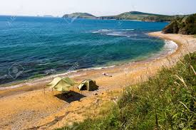 lone camping on desert beach on the russian isle putyatin stock
