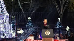 president obama family light the national christmas tree for the