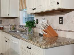 modern small kitchen design with mosaic backsplash and grey cool white kitchen design with neat knife storage and granite kitchen countertop idea