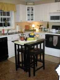 white cabinetry with granite countertop also black small island