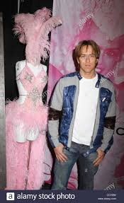 photographer larry birkhead stands next to a costume worn by his
