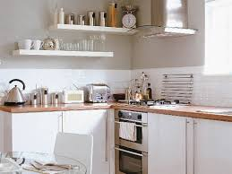white cabinets with butcher block countertops wood countertops with white cabinets tatertalltails designs
