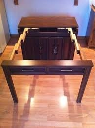 expanding cabinet dining table i live in central iowa and i have a saqinaw expandable buffet table