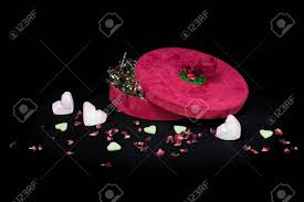 theme black rose valentines day concept on a black background present with candy