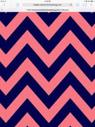 a cute dark blue and pink chevron wallpaper
