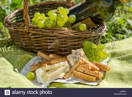 Wine Picnic Basket Picnic Basket With Wine Cheese And Grapes On A Grass Stock Photo