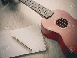writing concept paper paper note with ukulele selective focus on pencil sharpness paper note with ukulele selective focus on pencil sharpness concept for music writing stock