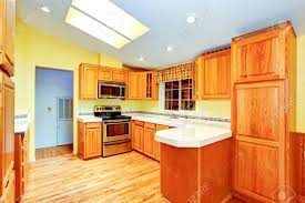 countryside house kitchen room interior maple cabinets with