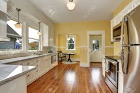 Yellow Kitchen With White Cabinets - kitchen interior with white cabinets stainless steel appliances
