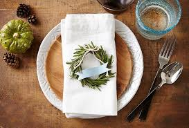 thanksgiving place settings rosemary wreath and pumpkin leaf