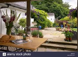 patio terrace garden table chairs and parasol sun shade stock