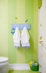 50 best bathroom images on pinterest kid bathrooms bathroom kids bathroom design with green striped wall and white shower curtain also white toilets and green