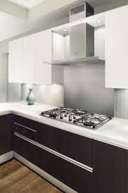 comely modern two tone style kitchen with white black colors
