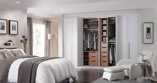decorating white folding closet doors on blue wall with baseboard