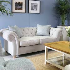 chesterfield sofa in living room maddox large chesterfield sofa choice of fabric chairs living