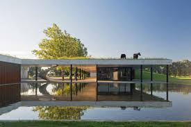 stunning modern stable treats horses to rooftop grazing curbed