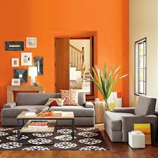 orange paint color ideas living room and grey sofa and table