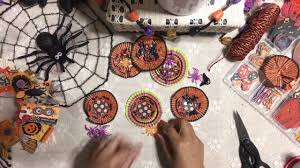 4 diy halloween cupcake liner embellishment using spiders