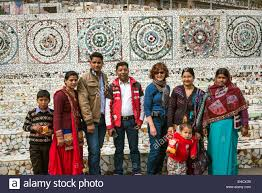 indian family visiting the nek chand rock garden in chandigarh