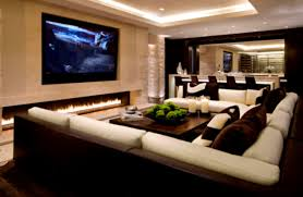 long cream fireplace completed with large tv above on the cream