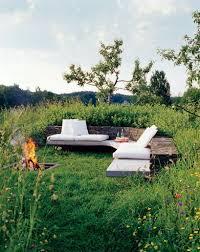 cosy area in a wild garden planters patios and plants