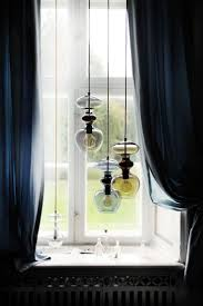 curtains for livingroom lighting hudson valley glass pendant with navy blue windows