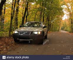 volvo canada volvo xc70 car on a country road in fall nature scenery algonquin