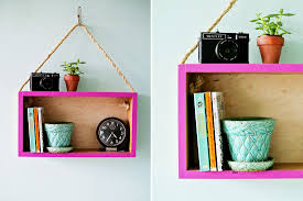 46 ways to decorate your dorm on the cheap brit co diy hanging shelf turn a basic wooden box into a statement shelf using only durable rope a standard drill and a bright pop of color