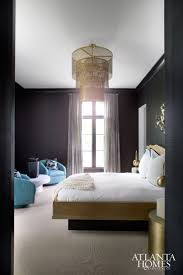 115 best bedrooms images on pinterest beautiful bedrooms atlanta daughter madison s bedroom continues the streamlined use of sleek black grasscloth walls and dramatic brass features such as the pendant light