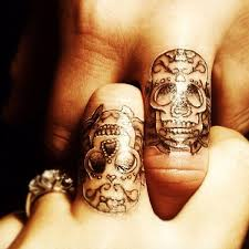 smiling with small skull tattoo on finger photos pictures