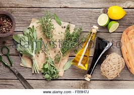 Table Top Herb Garden Fresh Garden Herbs And Condiments On Wooden Table Top View With